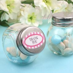 This vintage style bitsy glass candy jar are perfect to hold mini sweets or personalized m's while giving it a posh presentation. It comes with screw able tin cover to seal freshness. Stickers sold separately http://www.favorsandflowers.com/modern-personalized-medium-round-labels.htm