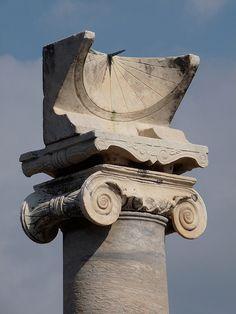 Roman sundial on top of an Ionic column in the Temple of Apollo, Pompeii, Italy.