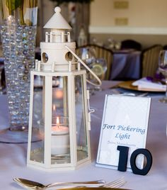 This couple loved to take trips to visit lighthouses.  So they made it their theme.  Make your theme personal.  Gina and Matt's love shone like the brightest beacon in New England during their wedding at the Downtown Harvard Club » Fucci's Photos of Boston–Something Blue Blog | Boston Wedding Photographer