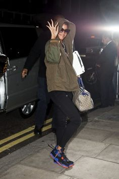 "Rihanna Photo - Rihanna Arrives in London! Rihanna arrives at her hotel after her trip to LA to the VMA's where she won the coveted MTV award for Video of the Year for ""We Found Love"". She was wearing a ""JOIN A WEIRD TRIP"" T-Shirt from Balenciaga Fall 2012. #Rihanna"