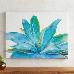 Even in the harshness of the desert, the agave plant's beauty unfolds, a reminder of nature's resilience and grace. With its dramatic perspective, our hand-painted artwork reveals the leaves' true colors and shapes, cast on a background of sun-bleached pink.