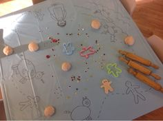 An idea on Tuesday: July 2015 Gingerbread Man- Playdough Activity... draw their favorite story, song, movie on a plastic tablecloth and tape to the table (light table),  add playdough, cutters, accessories to decorate characters and let the fun begin.