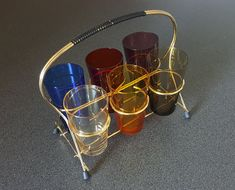 Set of 6 shot glasses in a rack, different colors, very cool 50s style #rockabilly #retrohomedecor