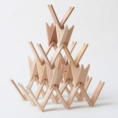 Japanese architect Kengo Kuma has created a modelling kit made up of triangular-shaped wooden pieces, which has been described as the Japanese alternative to Lego (+ slideshow).