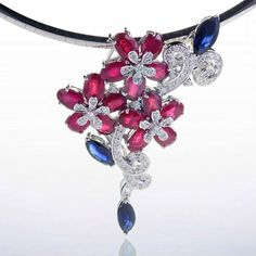 Hey, I found this really awesome Etsy listing at https://www.etsy.com/listing/110728823/floral-ruby-sapphire-diamond-pendant