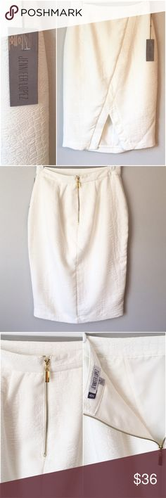 "FLASH SALE! Gorgeous NWT J-Lo Skirt This size 10, NWT Jennifer Lopez skirt is gorgeous! It is a beautiful off white color with a subtle croc pattern. The lines of this skirt are super slimming, it's fully lined and I love the gold zipper! When flat, the waist measures 15"" and the length is 27.5"". I'm tempted to say it's in perfect condition but I'm always nervous I miss something when I sell something white. But from my inspection it seems excellent!!! Reasonable offers welcome and don't…"
