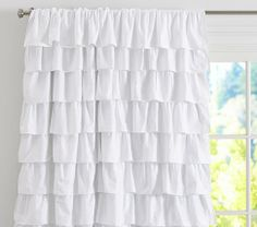 Still love the ruffles, but that is the price per but thankfully will only need one since window is small.  Ruffle Blackout Panel | Pottery Barn Kids
