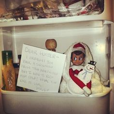 Day 4 hunters elf in the fridge, since he brought him a snowman who had to stay cold! Elf on shelf ideas #elfontheshelf
