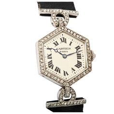 CARTIER PARIS Art Deco Diamond Watch France 1915 Very fine, rare, and elegant, hexagonal shaped, Art Deco, platinum, and diamond wristwatch with a diamond-set platinum and gold clasp.