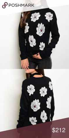 """🌞LAST 1🌞FLORAL SWEATER New with tags Black sweater with fun white flowers all over. Comfy and warm.   100%acrylic-  length21""""/ Bust 21.5 across.  Grab your favorite leggings or jeans and go! . Sweaters Crew & Scoop Necks"""