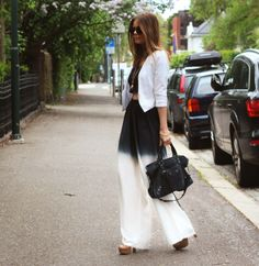 Ombre- black & white flowing dress pants, bear your body shape paired with a black crop top and cropped white blazer.