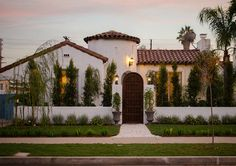 I love the low wall and door that frames the house. American Dream Builders Red Team Spanish House AFTER Mediterranean Architecture, Spanish Architecture, Mediterranean Style Homes, Spanish Style Homes, Spanish House, Spanish Colonial, Spanish Revival Home, Spanish Modern, Spanish Tile