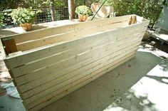 Very detailed, very enthusiastic how-to for building a tall, long planter box. It includes instructions on how to line it and fill it with soil.: