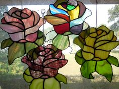 Handmade Stained Glass Rose Flower Suncatchers by GCStainedGlass, $26.00 Love them all, but the multi (no!)