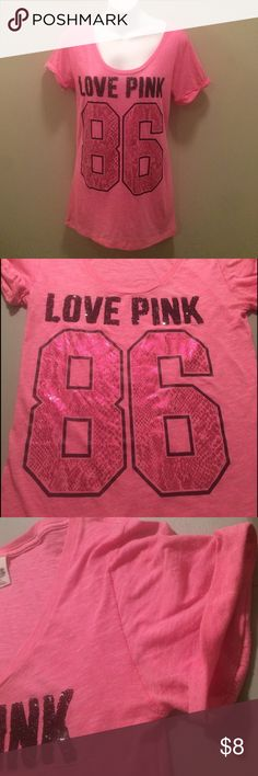 """Victoria Secret PINK Victoria Secret PINK top. LOVE PINK is written in black sequins and the 86 has a reflective pink snake skin print. The cuffs are pressed to be folded. This shirt has been worn and has some pilling. Size Medium, measures approximately 27"""" from shoulder to bottom hem. PINK Victoria's Secret Tops"""