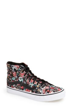 Pair these flirty, femme red flower print vans with a skater dress.