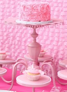 Get past the pink color and see it's a pretty neat idea to turn an old chandelier into a cute cake stand!