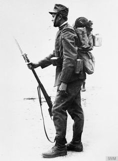 An Italian soldier in full marching order.