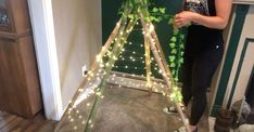Looking for a magical space to sit and read a book? This DIY twinkle light teepee tent is the perfect project for you! Highly customizable, this DIY tent is perfect for both kids and adults alike. Add faux greenery to bring the outdoors inside, or plant vines near it outside and watch them grow. Crawl inside your teepee and cozy up with a good book and a cup of tea, or watch your children's imaginations run wild as they play inside, the possibilities are endless. Follow my step-by-step ... Diy Teepee Tent, Teepee Party, Play Tents, Twinkle Lights, Twinkle Twinkle, Spray Paint Vases, Concrete Bird Bath, Hanging Plant Wall, Weathered Paint