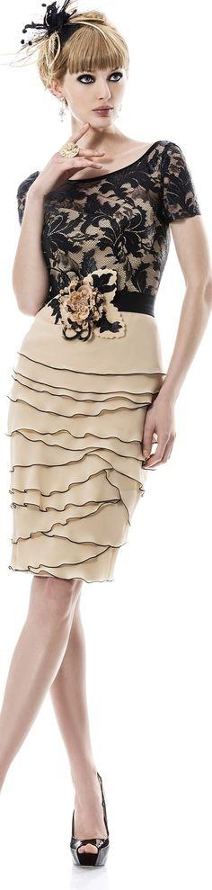 Blonde hair done up w/ black bow, black lace blouse over strapless cream midi dress (multilayer skirt w/ black trim), black & silver stiletto platforms ~ Angela Ariza