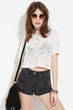 A pair of denim shorts featuring a distressed front, a cuffed hem, a five-pocket construction, and a zip fly. #f21denim