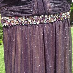 Glittering Strapless Long Plum Color Dress Strapless. Gemstone belt design above waist. Semi-Sweetheart neckline. Has tan color lining. It is absolutely beautiful!!!!! If you're 5'3 or shorter you must wear with high heels as it is very long. That's me on photo w/out shoes and I'm 5'3. Dresses