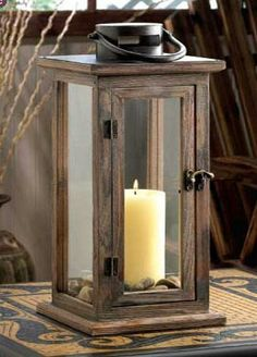 Wood, metal and glass #combine to create the ideal candle #lantern, with a design that isequallyfamiliar and fantastic. This inspired lighting accent features a stained wood framework, a fascinating top loop for hanging, and a vintage-inspired metal door latch. The elongated glass panels let the light from your #candle shine bright. At zealsone.com