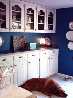 Beautiful cobalt blue and white kitchen- so pretty  on the color and cabinet style