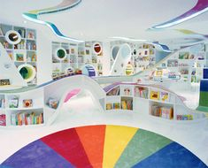 Kids Book Store in Beijing China. Amazing playground, the walls of are covered with bookshelves and round windows double as relaxing reading areas.