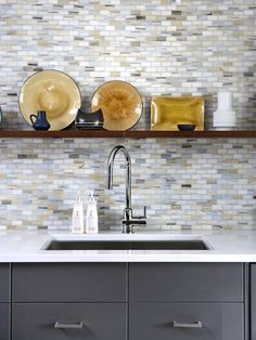 charcoal cabinets, quartz countertops, mini brick pattern mosaic, open wood shelves
