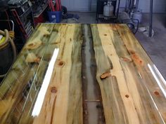 """I just spent the last month building a """"live edge"""" table made from """"blue bug wood"""" and now I want to sell it. It measures 4 feet wide by 6 feet long and is 32 inches high. It is covered in 4 gallons of clear epoxy and has a """"river scene"""" down the center of the table. The river scene has 2 bridges with people fishing from them a fisherman walking along the shore and at least one of the rocks along the shore has a speck of gold in it. The """"river"""" glows a soft blue in the dark that looks very…"""