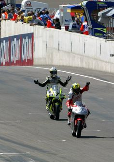 Rolfo punches the air after taking his first GP victory, in Germany, from de Puniet.