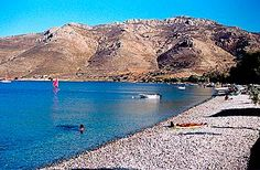 Beach in Tilos (Dodecanese) Greece Beaches, Places In Greece, Beach Village, Visit Greece, Us Sailing, Greece Islands, Crystal Clear Water, Medieval Castle, Greece Travel