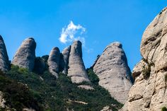 a mountain range and home to a mystical monestary, has been the spiritual heart of Catalonia for centuries. Shore Excursions, Mountain Range, Day Tours, Day Trip, Mystic, Mount Rushmore, Places To Go, Barcelona, Spiritual