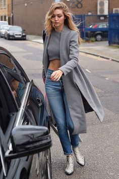 Gigi Hadid wearing Lavish Alice Grey Marl Royal Tie Coat, Lavish Alice Grey Marl Press Stud Detail Racer Crop Top, Zadig & Voltaire Mods Boots in Python and Re/Done High Rise Crop Jeans Estilo Gigi Hadid, Gigi Hadid Style, Winter Fashion Outfits, Autumn Fashion, Elle Moda, Street Fashion Show, Snake Print Boots, Gigi Hadid Outfits, Gigi Hadid Fashion