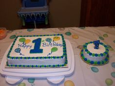 I made this for my Grandson's 1st Birthday.  It is Buttercream and the balloons are made from Candy Clay.