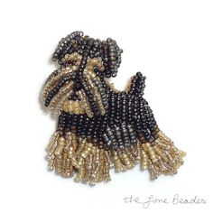 MADE to ORDER: One bead-embroidered Miniature Schnauzer pin pendant in black & tan.. Tiny glass seed beads were stitched to felt (2-3 at a time)