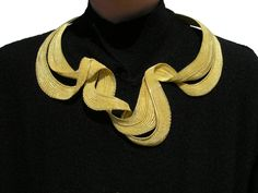 Mary Lee Hu hand weaves magic with 18k and 22k gold wires -- a true artisan jeweler.