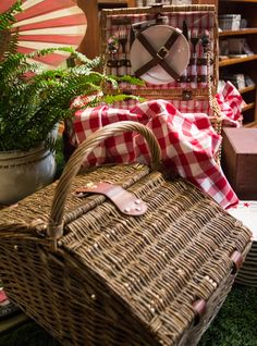 Wicker hampers stocked with plates and cups organize your next picnic with panache. Just add quiche and a bottle of wine for an al fresco afternoon.  http://rogersgardens.com/home-decor/