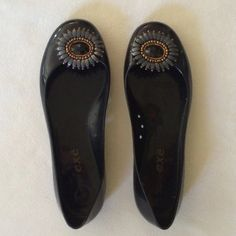Exe Brand Flats Black flats with beautiful decorative floral embellishments! Great condition! I originally paid around $90 for these! I'm not sure the exact material but they feel kinda rubbery and are so comfy! Exe Shoes Flats & Loafers