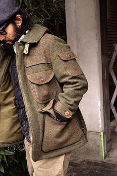 Men's Tweed coat. When I travel I really love this pockets on a jacket or a coat like this.
