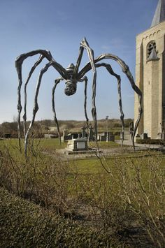 """""""Maman"""" - Louise Bourgeois - Beaufort 2002 (Oostende, Belgium) Protecting the grave of James Ensor."""