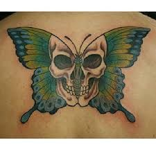Image result for butterfly skull tattoo                              …