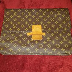 Louis Vuitton  Vintage File, tablet Holder Back zip pocket, Front tuck flap, 2 lrg body pockets and 1 zip pocket inside, Perfect for iPad or tablet, files of any kind.  I love this but I need to sell everything.  100% Proceeds go to families from fraud. A single mom and her 3 kids were left destitute by her ex husband after he fled indictment by the FBI. No child support/alimony and no warning. Their whole life was a lie and now their left to pick up the pieces through foreclosure and…
