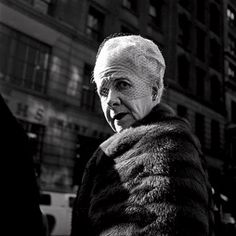 Vivian Maier Photo...candid snaps of unwilling subjects...this is my favorite. That lady is striking and heartbreaking all at once.