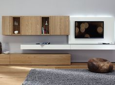 Wall-mounted wooden storage wall Neo Collection by Hülsta-Werke Hüls