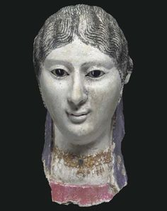 AN EGYPTIAN PLASTER MUMMY PORTRAIT OF A WOMAN ROMAN PERIOD, CIRCA LATE 1ST CENTURY A.D.