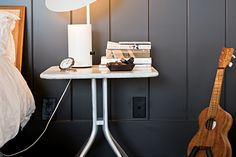 "8 Cool Bedside Table Solutions Beyond The Dull Nightstand #refinery29  http://www.refinery29.com/dwell/14#slide7  Matt Jacobson doesn't just abide by the mantra ""less is more,"" he wholeheartedly embraces it. His Southern California home is a compact ode to minimal living. Prized possessions that made the cut: A George Nelson Half-Nelson lamp sits atop an Alexander Girard bedside table."