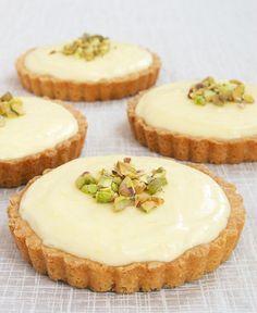 Lemon Cream Tarts feature a sweet, tart, creamy lemon filling inside a sugar cookie crust. Delicious!