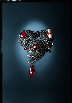 La Coeur pin by Yves Saint Laurent, 1962  In every one of his shows, M. Saint Laurent would give La Coeur to the model in his favorite outfit to wear during the show as a good luck charm of sorts.